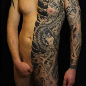 Black and skin half suit tattoo by S V Mitchell